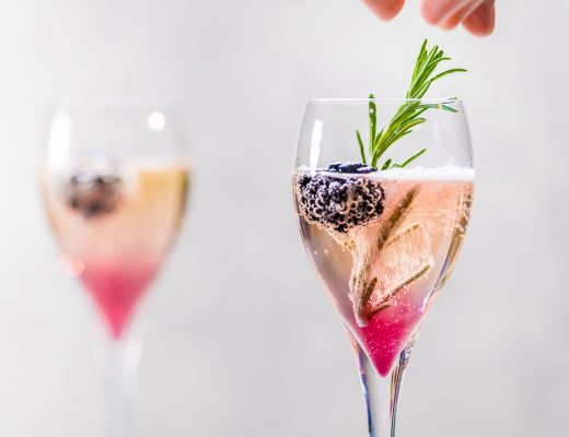 Champagne cocktail with blackberries and rosemary