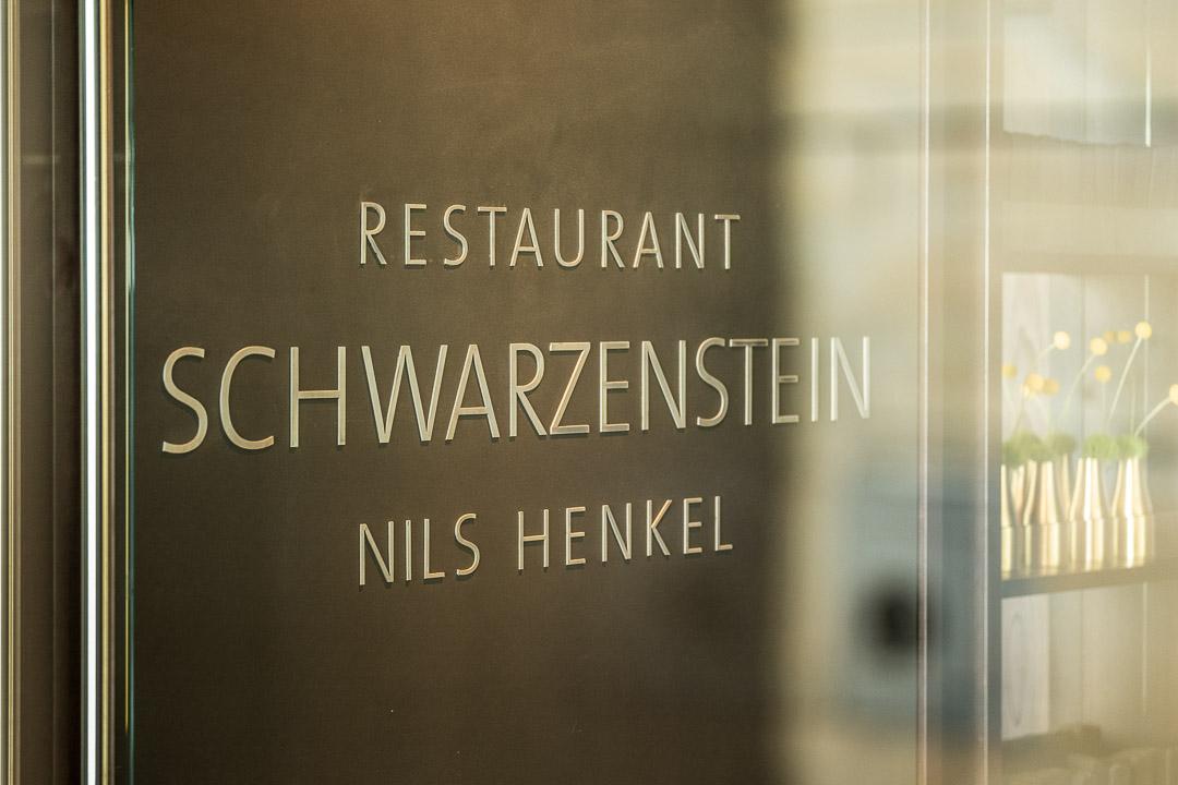 Burg Schwarzenstein and Nils Henkel by Hungry for More. Restaurant Schwarzenstein logo.