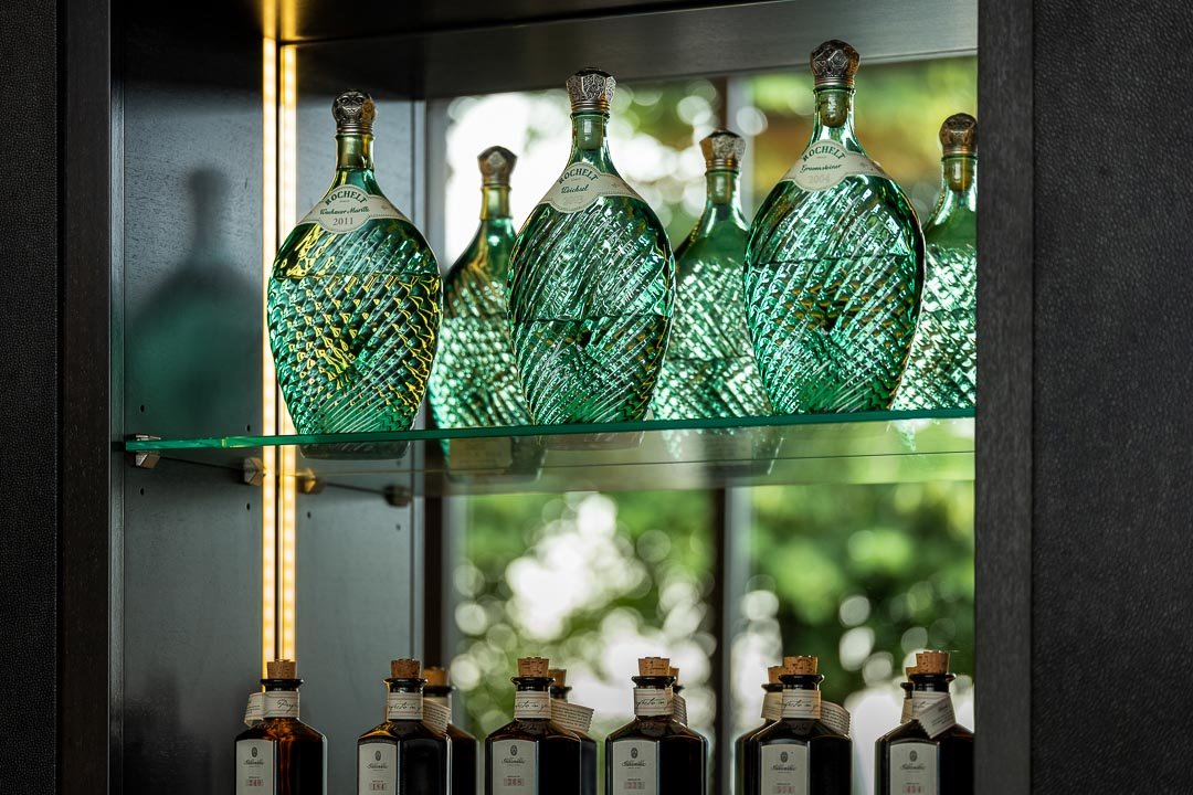 Burg Schwarzenstein and Nils Henkel by Hungry for More. Bottles in a cabinet.