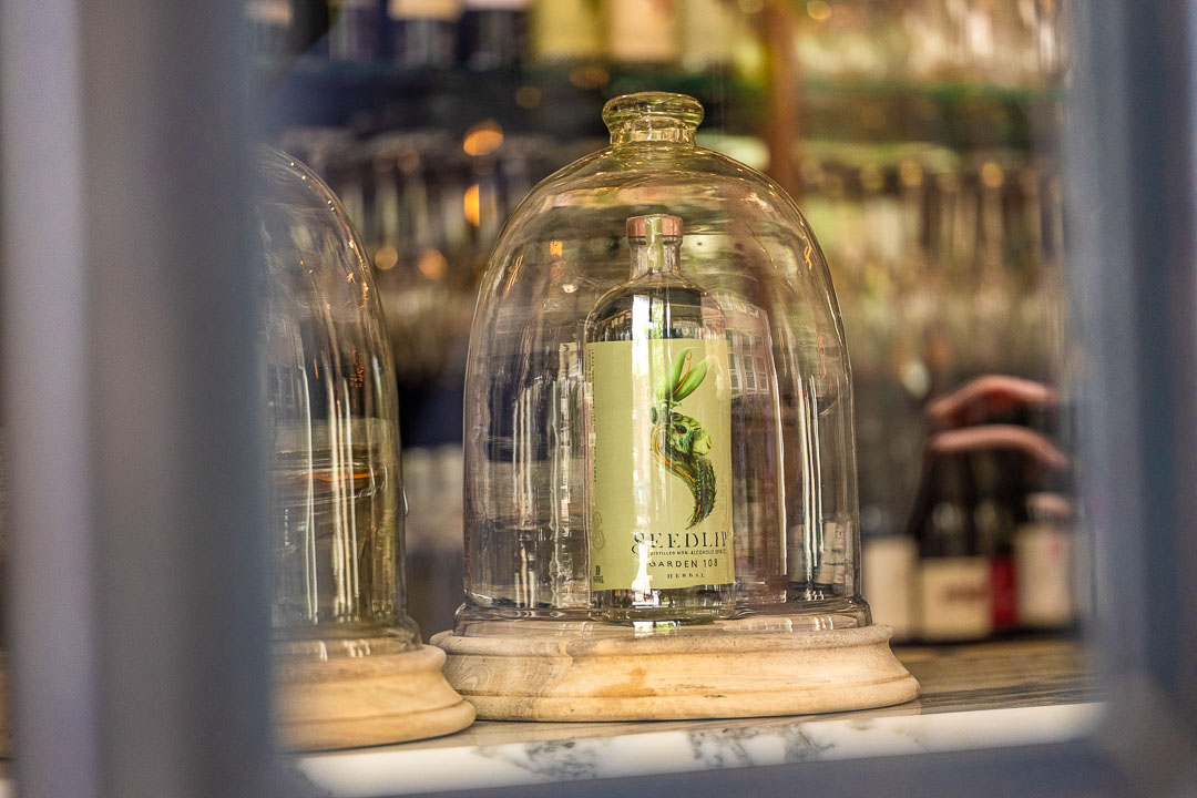Glass bell jar with Seedlip Garden 108 non-alcoholic spirit at Restaurant Daalder in Amsterdam.