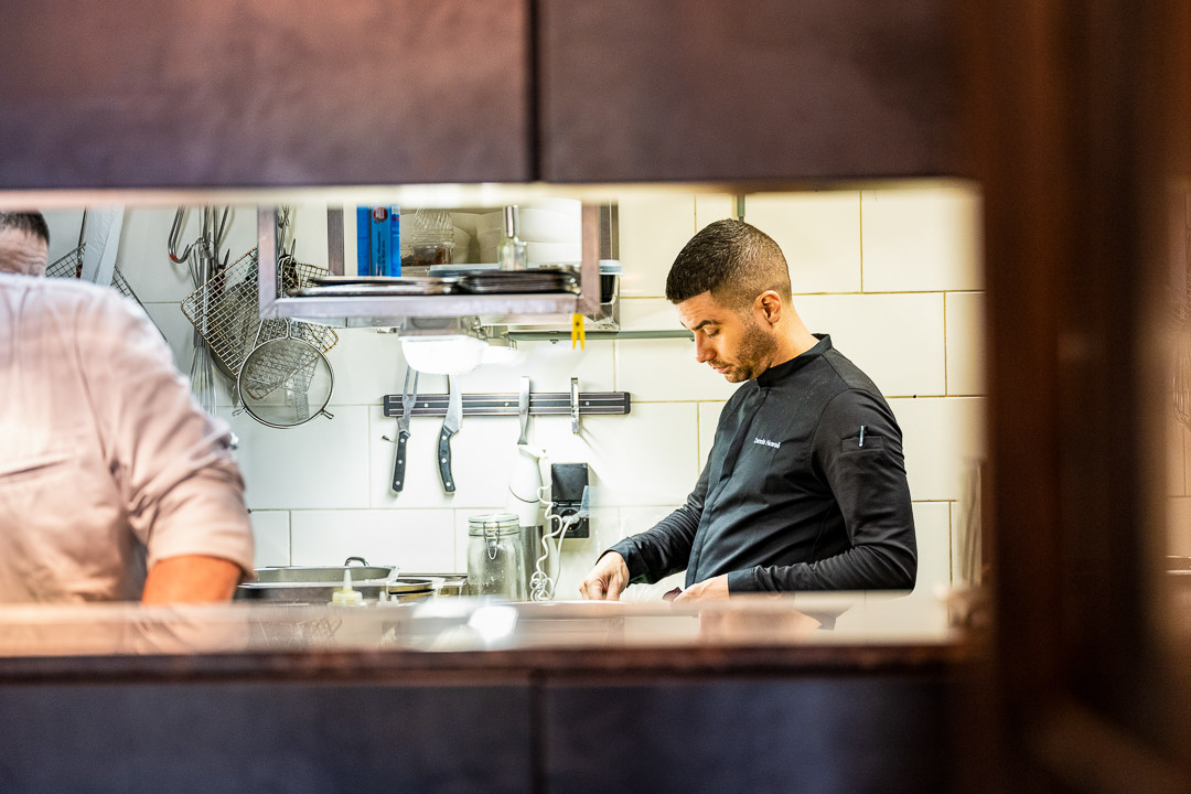 Dennis Huwaë and other staff working in the kitchen at Restaurant Daalder in Amsterdam.