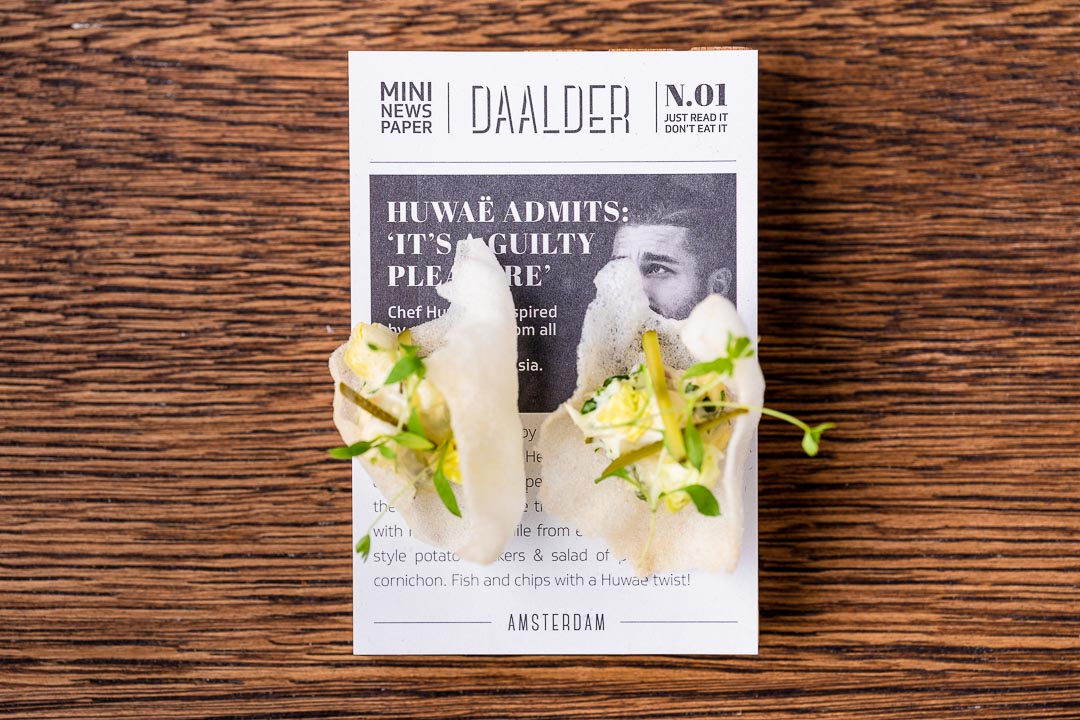 Fish and chips on a mini newspaper at Restaurant Daalder in Amsterdam