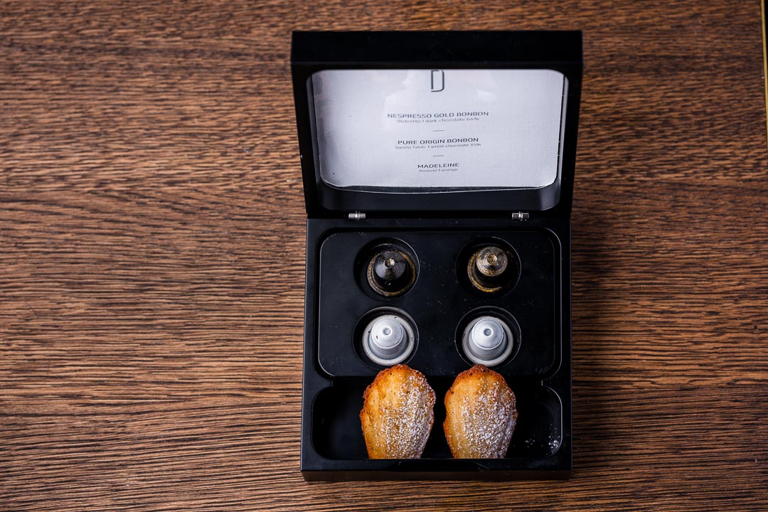 Box with Nespresso capsules and madeleines on a table at Restaurant Daalder in Amsterdam