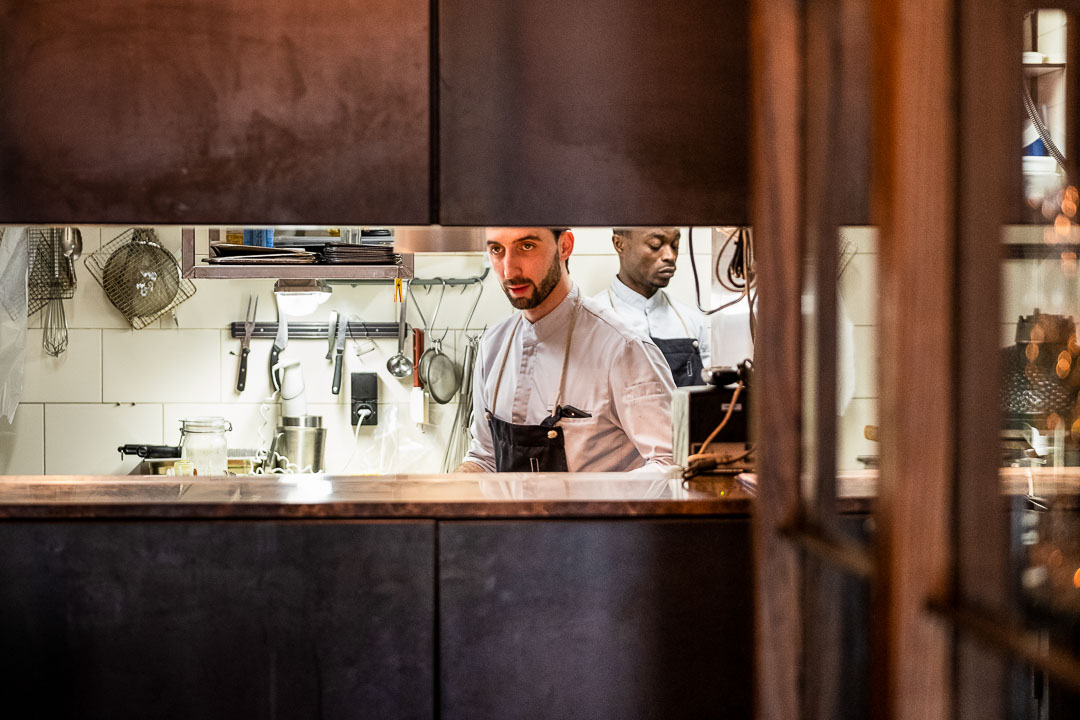 Male staff in the kitchen at Restaurant Daalder in Amsterdam.