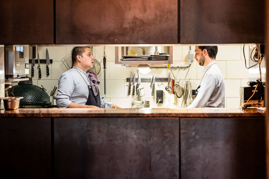 Male staff working in the kitchen at Restaurant Daalder in Amsterdam