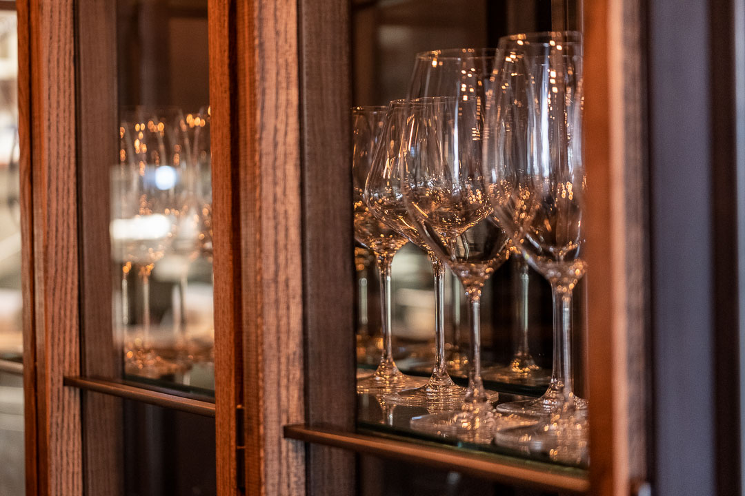Cabinet with wine glasses at Restaurant Daalder in Amsterdam. Close-up.