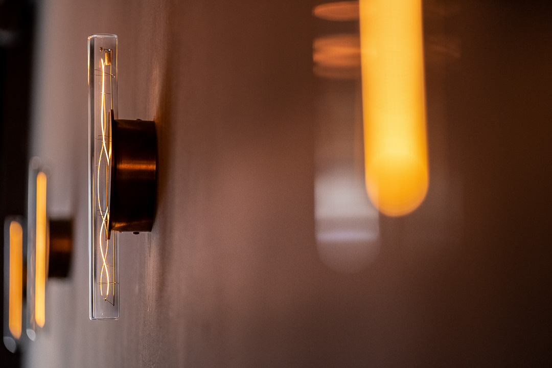 Modern wall light fixtures at Restaurant Daalder in Amsterdam.
