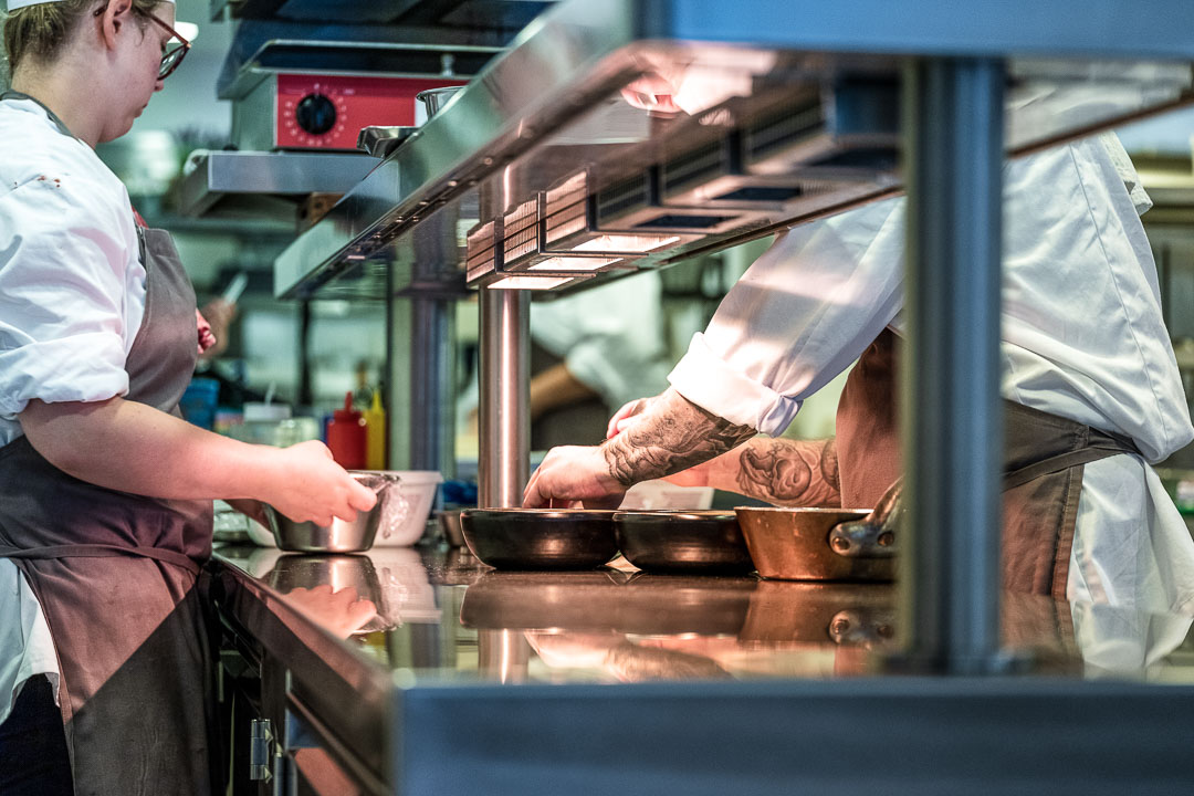 Kitchen Action. Male and female staff. Close-up. Auberge De Herborist by Hungry for More.