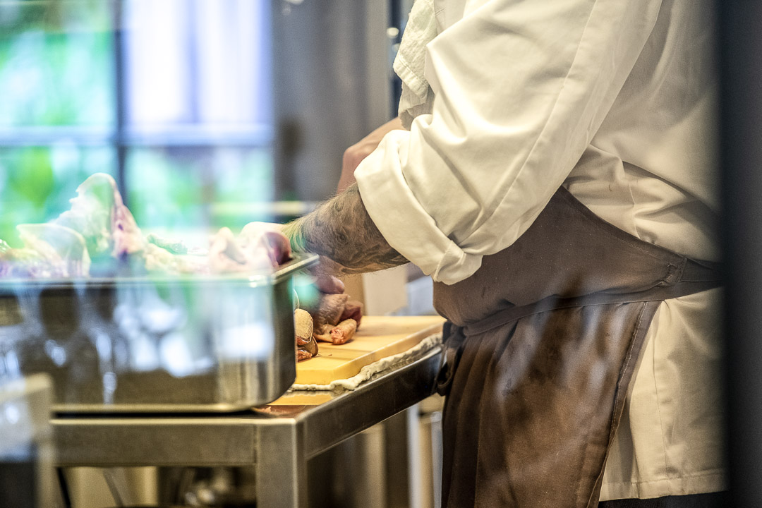 Kitchen Action. Male staff with tattoo. Auberge De Herborist by Hungry for More.