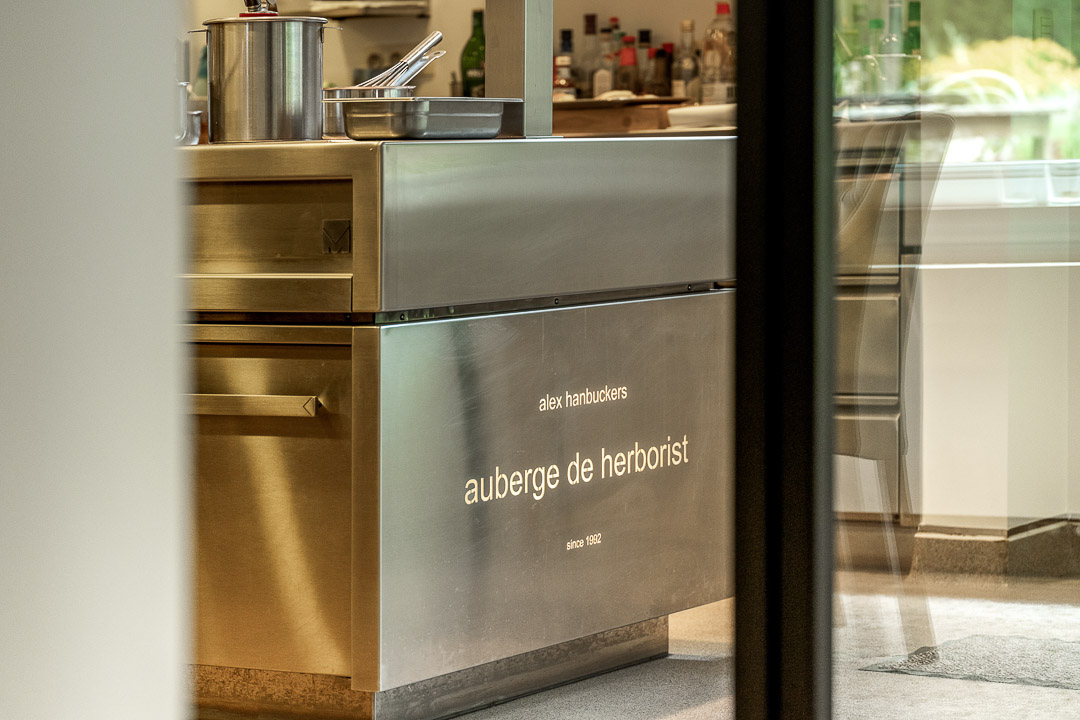 Kitchen logo on a stove. Auberge De Herborist by Hungry for More.