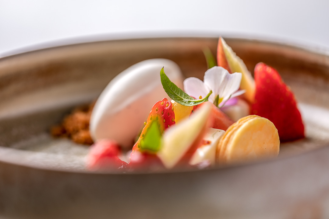 Panna cotta with calvados, strawberry, apple, basil and vanilla. Close-up. Auberge De Herborist by Hungry for More.
