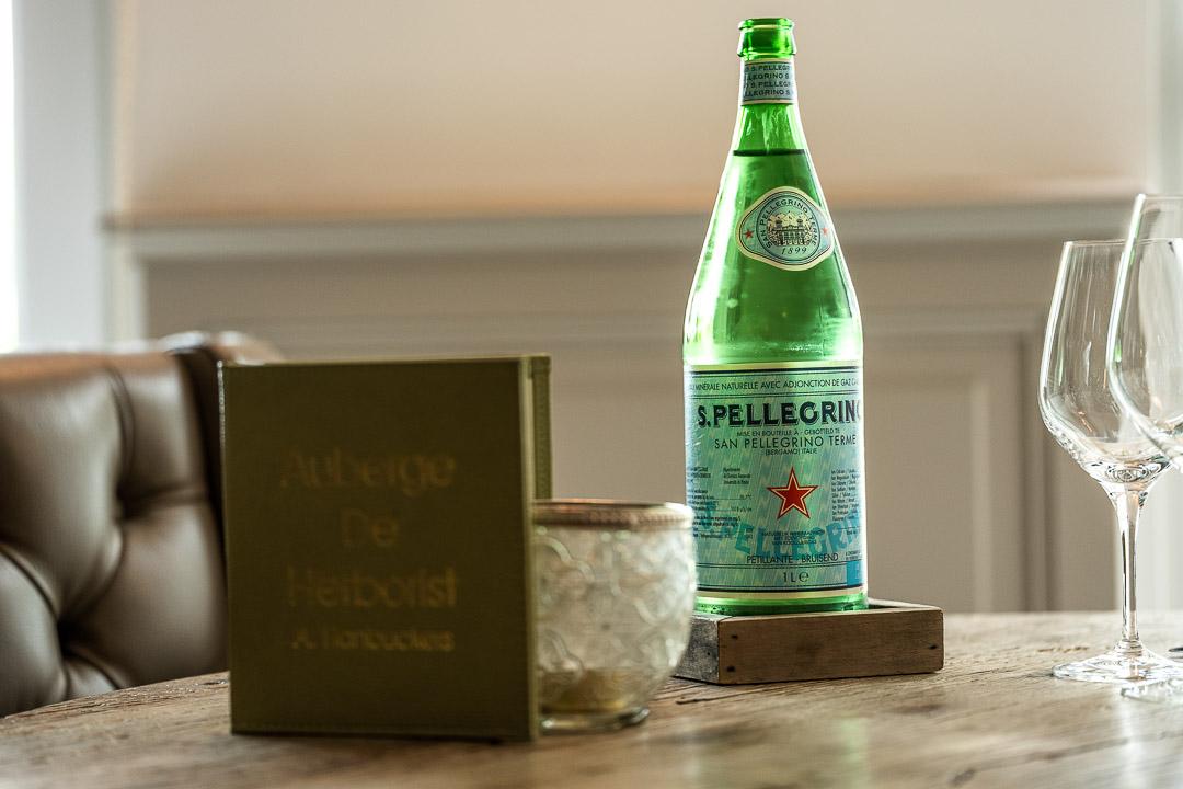 S.Pellegrino bottle. Auberge De Herborist by Hungry for More.