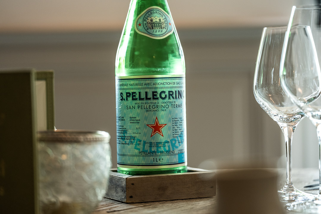 S.Pellegrino bottle. Close-up. Auberge De Herborist by Hungry for More.