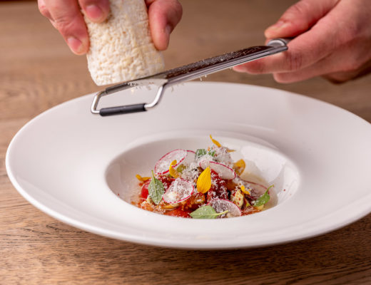 Zarza Leuven by Hungry for More. Chef Gert Cordemans grating goat cheese on top of the dish.