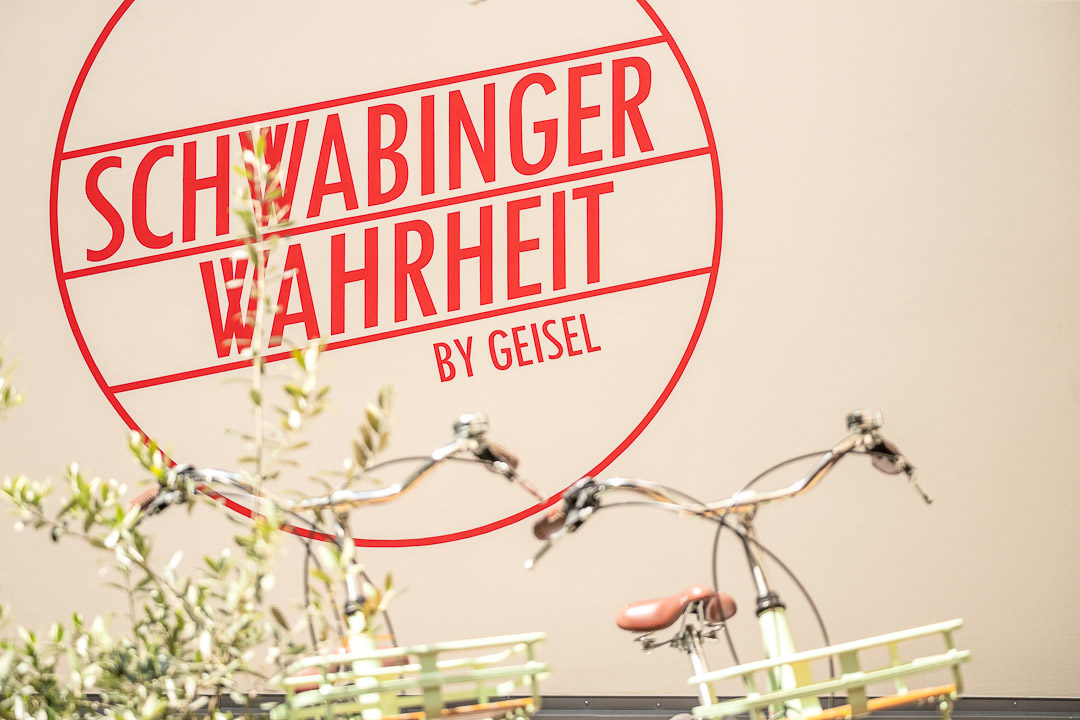 Schwabinger Wahrheit Munich by Geisel by Hungry for More. Logo.