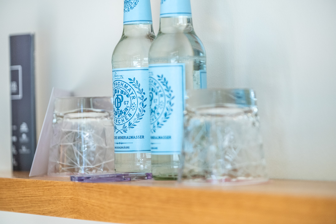 Schwabinger Wahrheit Munich by Geisel by Hungry for More. Two bottles of water and two glasses.