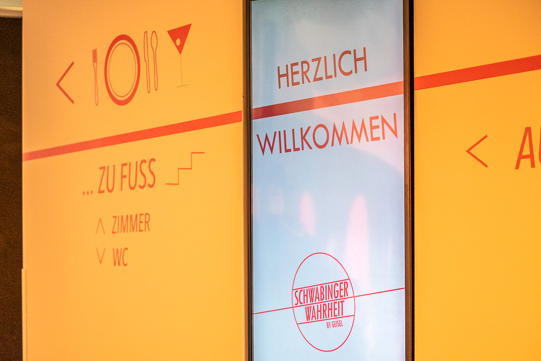 Schwabinger Wahrheit Munich by Geisel by Hungry for More. Sign that says 'HERZLICH WILLKOMMEN'.