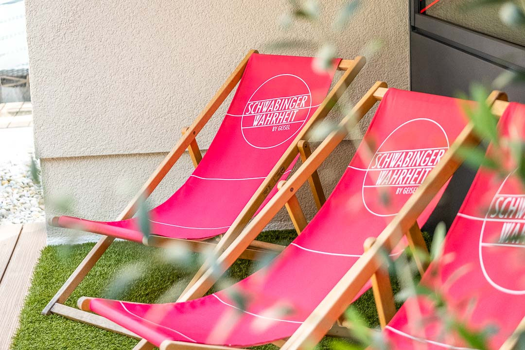 Schwabinger Wahrheit Munich by Geisel by Hungry for More. Lounge chairs with logo.