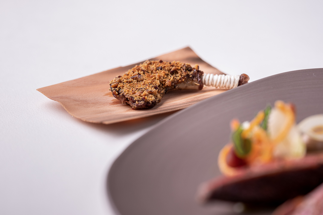 Werneckhof Munich by Hungry for More. Anjou Pigeon, carrot, pecan nut, passion fruit & curry leaves. Close-up 1.