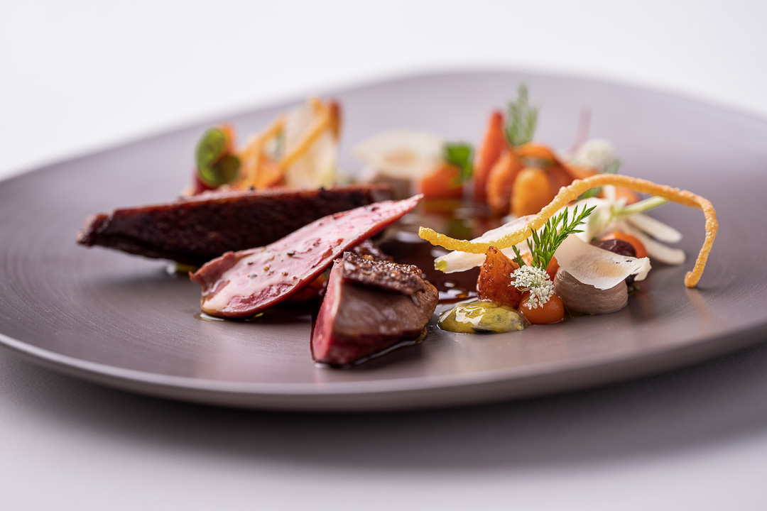 Werneckhof Munich by Hungry for More. Anjou Pigeon, carrot, pecan nut, passion fruit & curry leaves. Close-up 3.