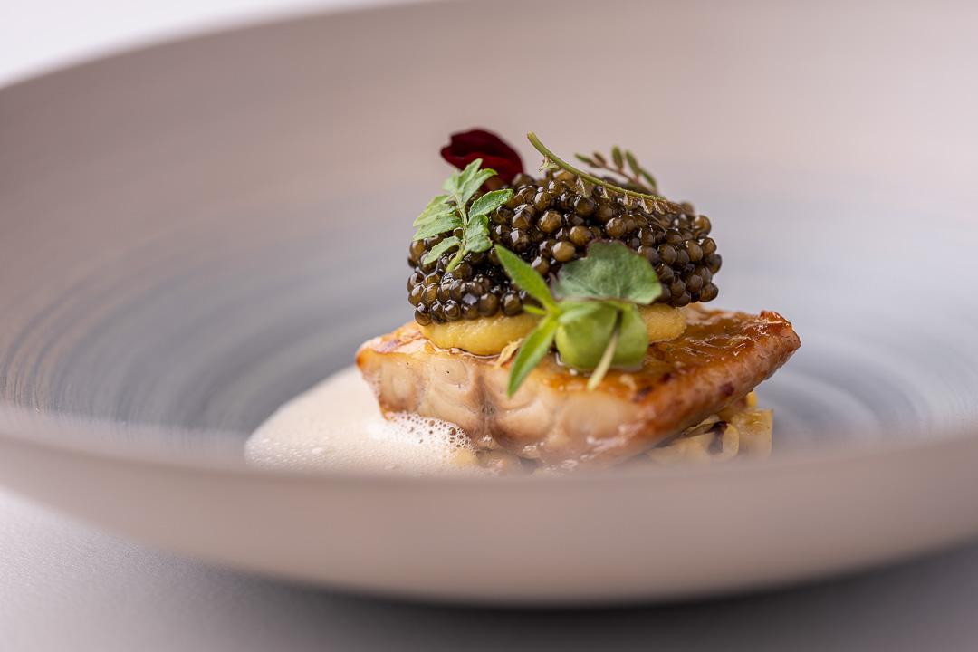 "Werneckhof Munich by Hungry for More. Eel ""Shirayaki"", N25 caviar, sweetcorn, verbena & Sake. Close-up."