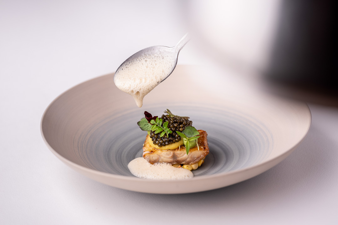 """Werneckhof Munich by Hungry for More. Eel """"Shirayaki"""", N25 caviar, sweetcorn, verbena & Sake. Action view."""