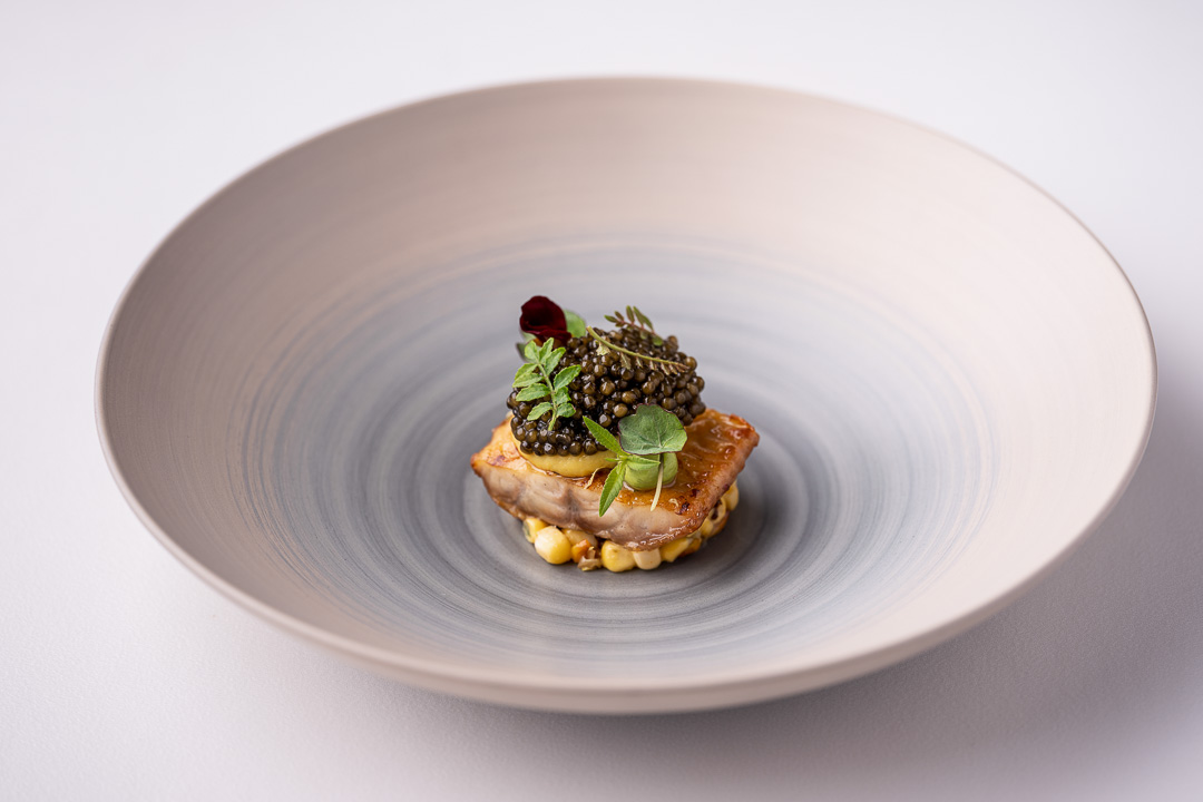 """Werneckhof Munich by Hungry for More. Eel """"Shirayaki"""", N25 caviar, sweetcorn, verbena & Sake. Front view 1."""
