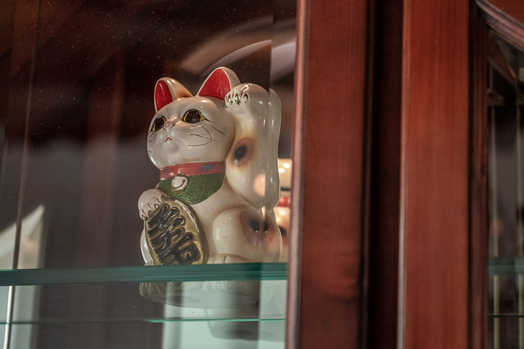 Werneckhof Munich by Hungry for More. Interior. Lucky cat in a glass cabinet.