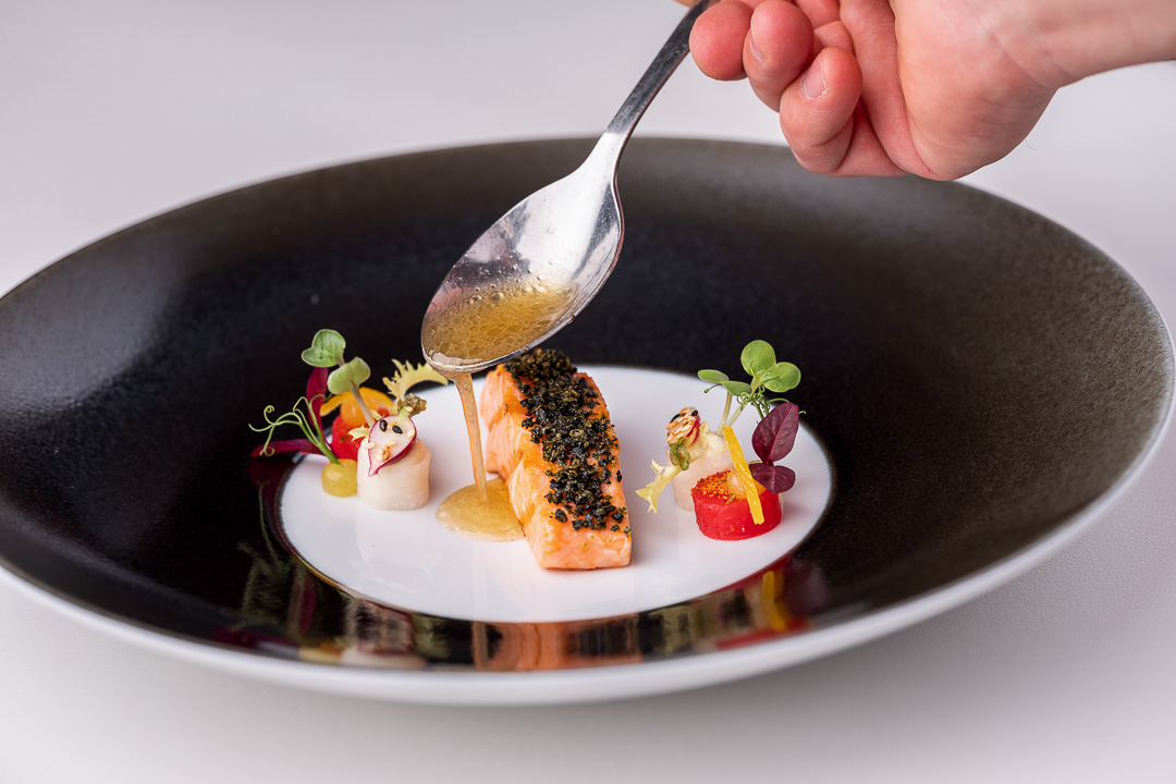 Werneckhof Munich by Hungry for More. Bavarian Salmon Trout, radish, Yuzu, sesame & toasted Kombu. Front action view.