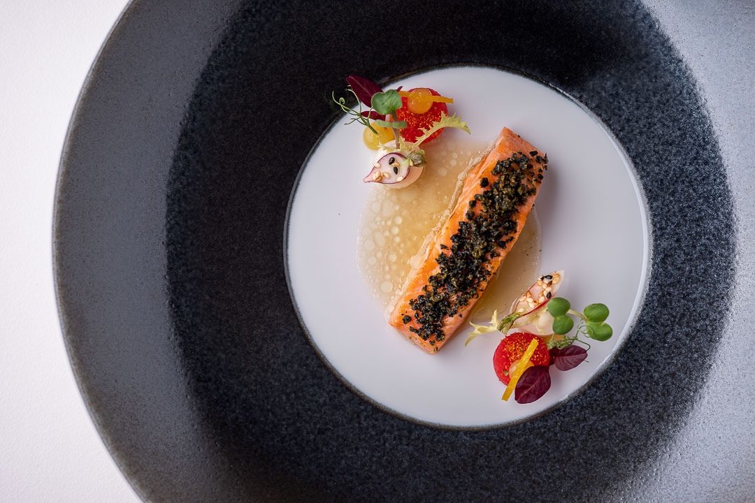 Werneckhof Munich by Hungry for More. Bavarian Salmon Trout, radish, Yuzu, sesame & toasted Kombu. Top view.