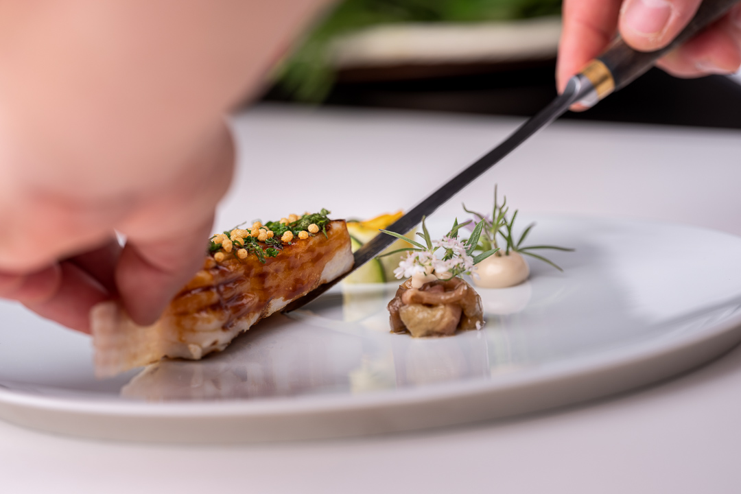 Werneckhof Munich by Hungry for More. Skate Wing, fennel, octopus, Koshihikari & spicy fish soup. Front action view 1.