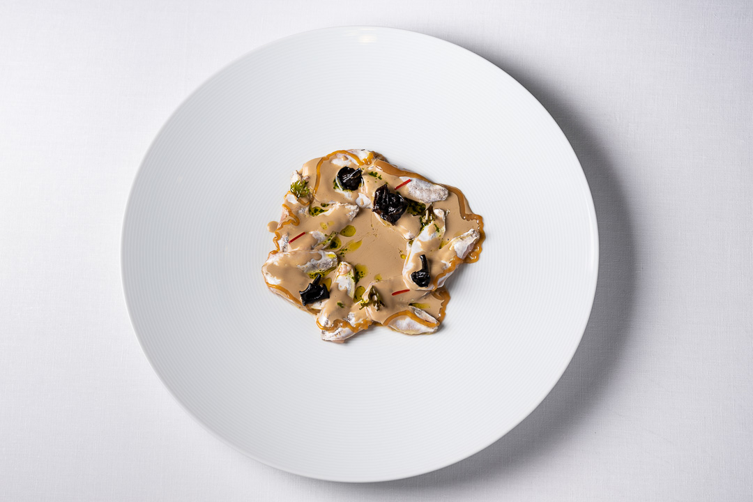 Enoteca Paco Pérez by Hungry for More. Top shot of the dish with hake fish by chef Xisco Simon.