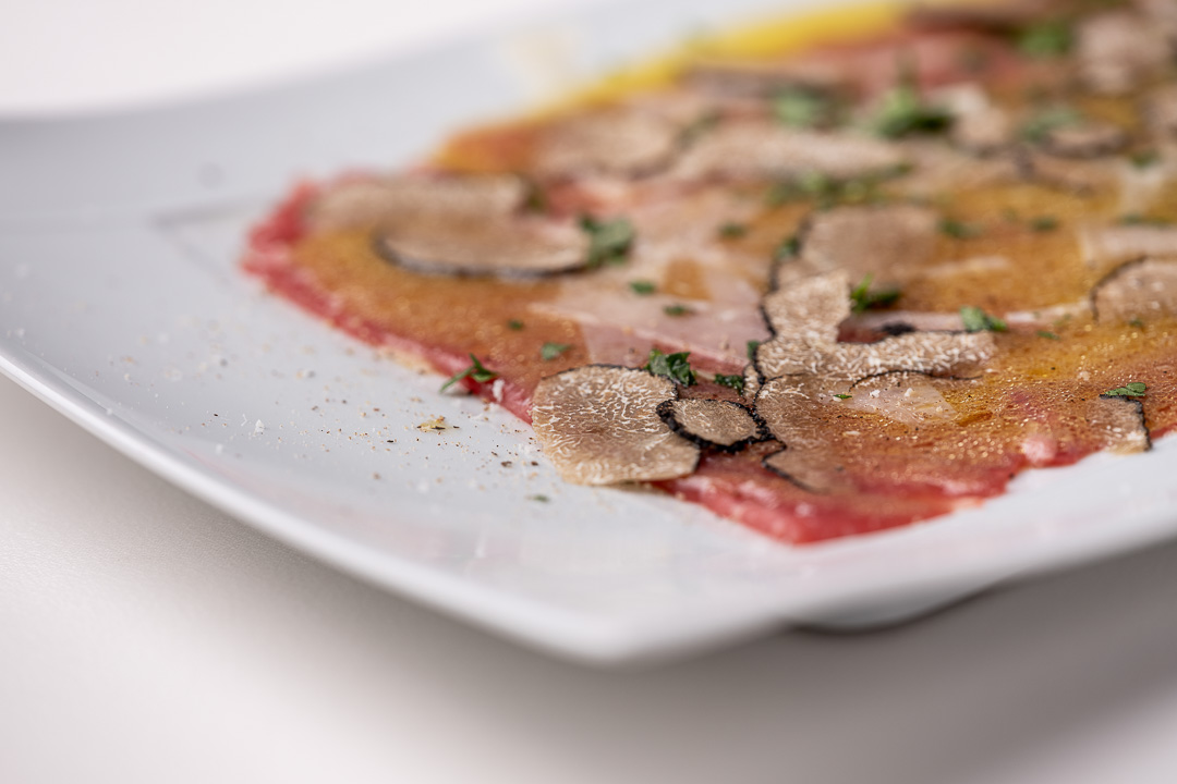 La Truffe Noire by Hungry for More. Details of the famous carpaccio by chef Luigi Ciciriello.