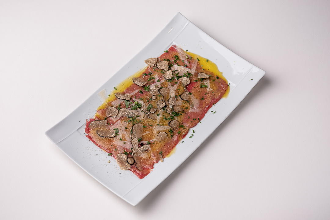 La Truffe Noire by Hungry for More. Top shot of the famous carpaccio by chef Luigi Ciciriello.