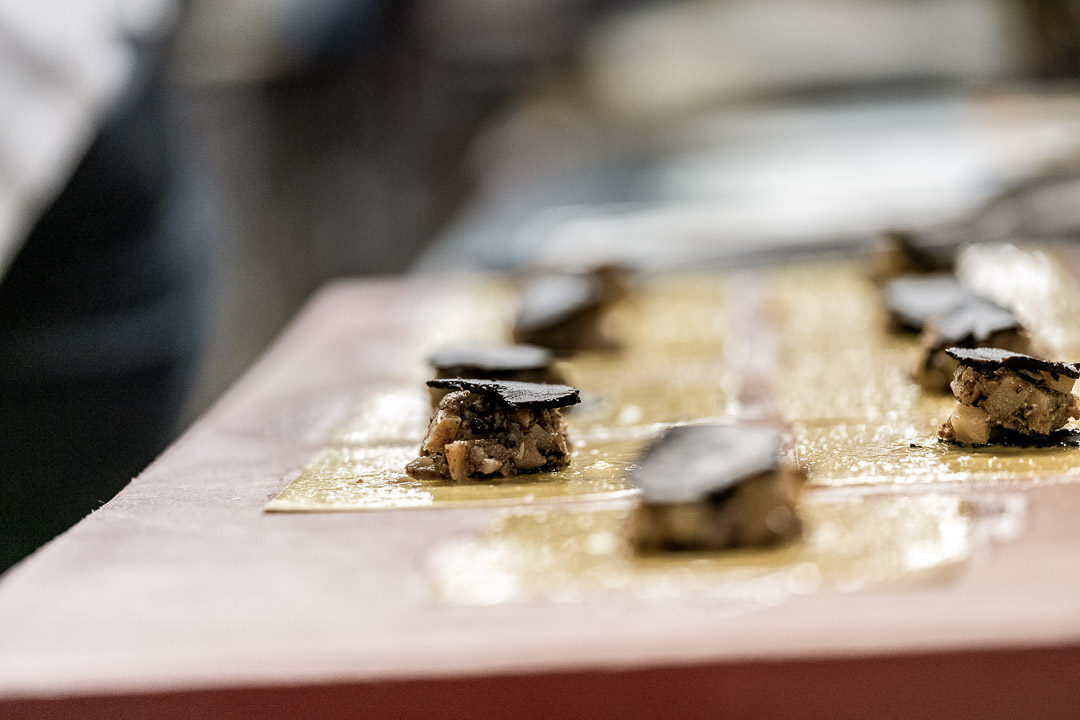 La Truffe Noire by Hungry for More. Kitchen team preparing the ravioli with black truffle.