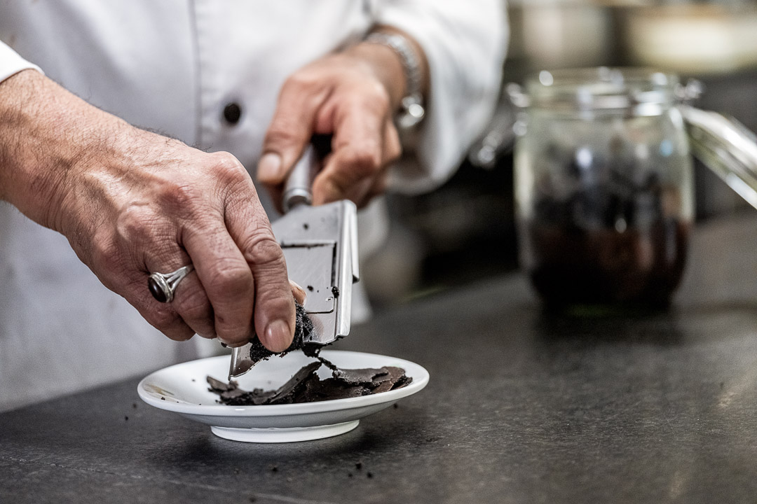 La Truffe Noire by Hungry for More. Kitchen team making slices of black truffle.