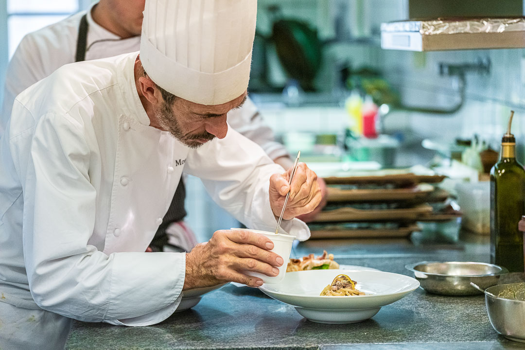 Mosconi by Hungry for More. Chef Ilario Mosconi finishing one of the dishes.