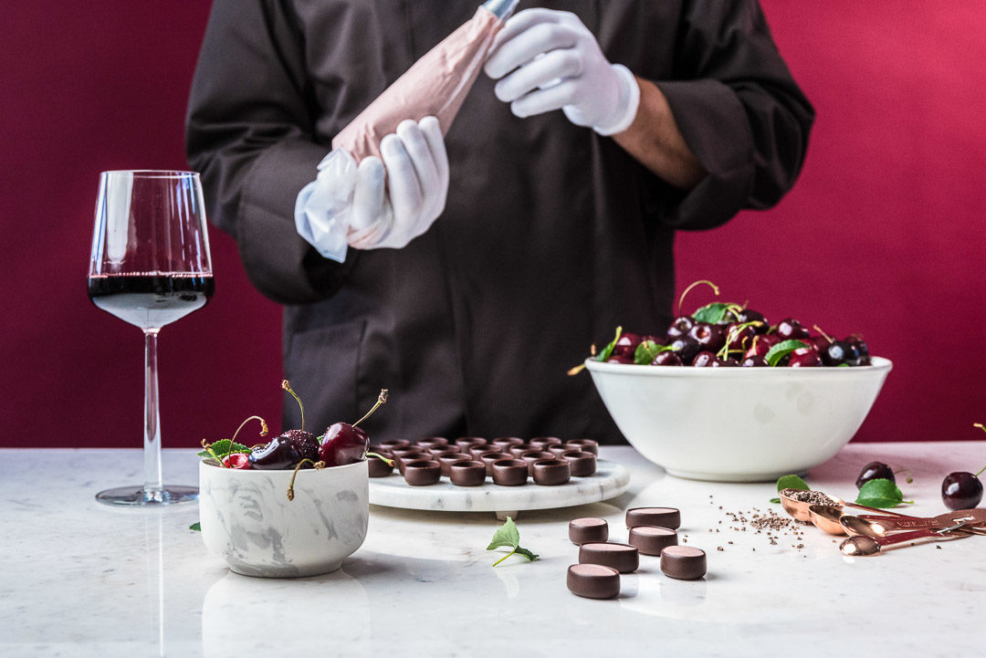 Neuhaus x Sepideh by Hungry for More. Chocolatier Olivier making the chocolates with cherry.