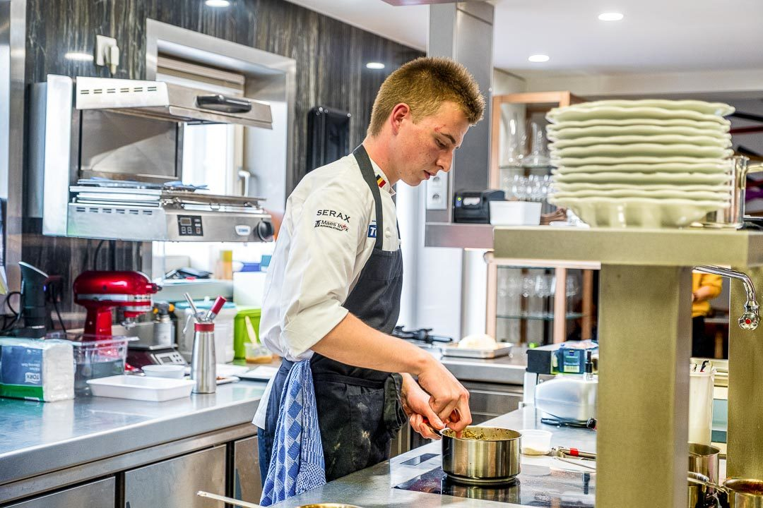 S.Pellegrino Young Chef by Hungry for More. Close-up of Guus who's preparing the sauce for his dish.
