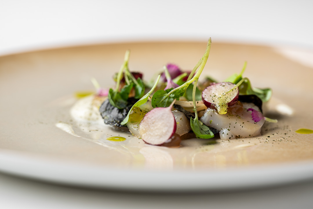Kommilfoo by Hungry for More. Details of the dish with coquilles by chef Olivier de Vinck.