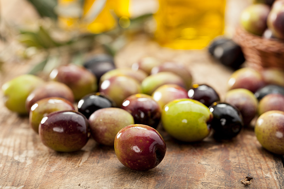 iStock. Different types of olives together.