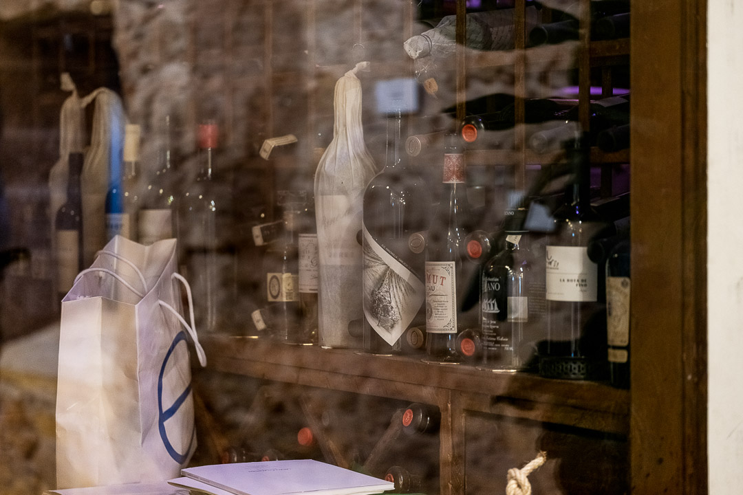 Aponiente by Hungry for More. Interior. Glass cabinet with wine bottles.