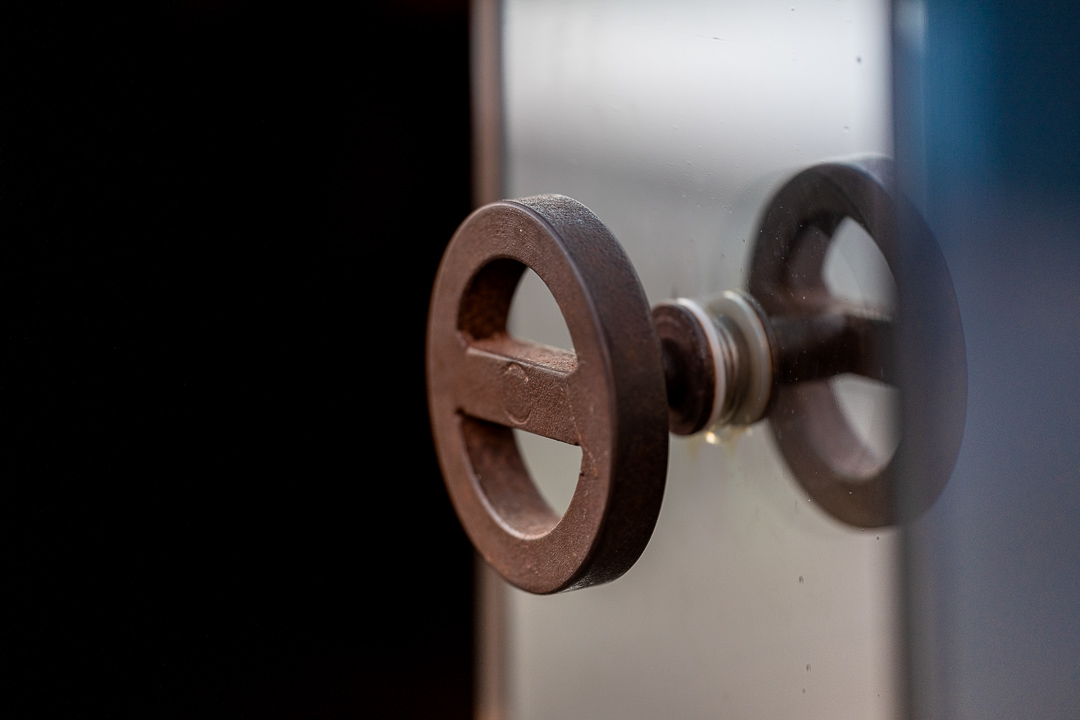 Aponiente by Hungry for More. Interior. Close-up of steel logo handle.