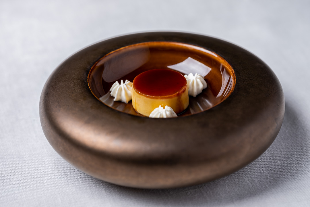 Aponiente by Hungry for More. Mullet roe, crème caramel, custard made with mullet roes and whipped cream imitating a classic Spanish dessert. Front view.