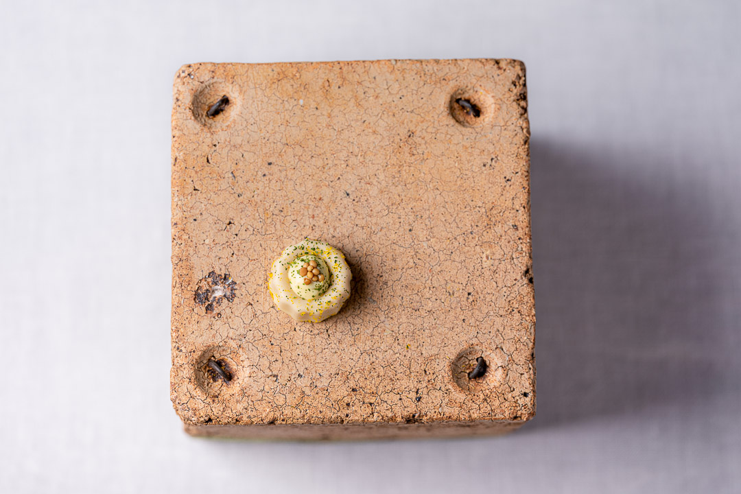 Aponiente by Hungry for More. Sardine canelé, classic petit fours from Bordeaux, made of dried sardines and mustard. Top view.