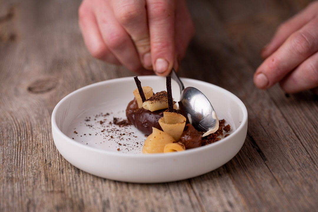 L'Envie by Hungry for More. Chef David Grosdent finishing the chocolate dessert with ice cream.