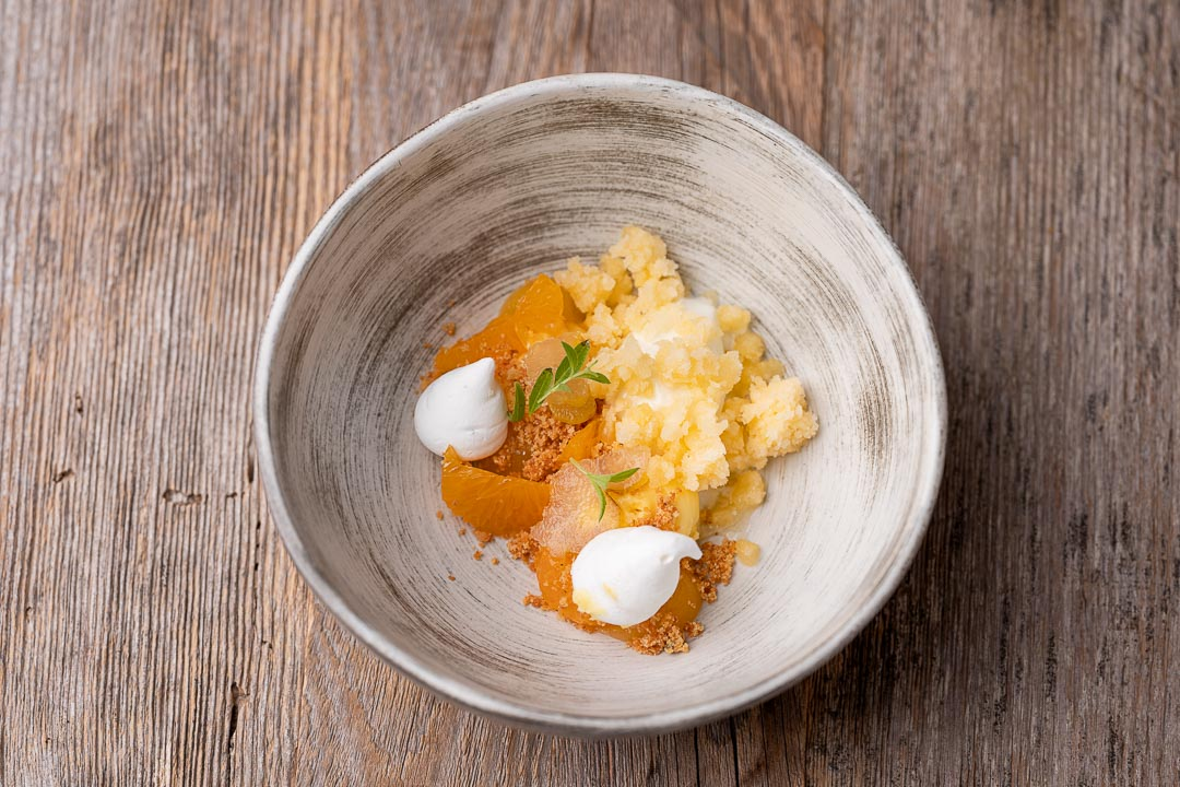 L'Envie by Hungry for More. Top shot of the citrus fruit dessert by chef David Grosdent.