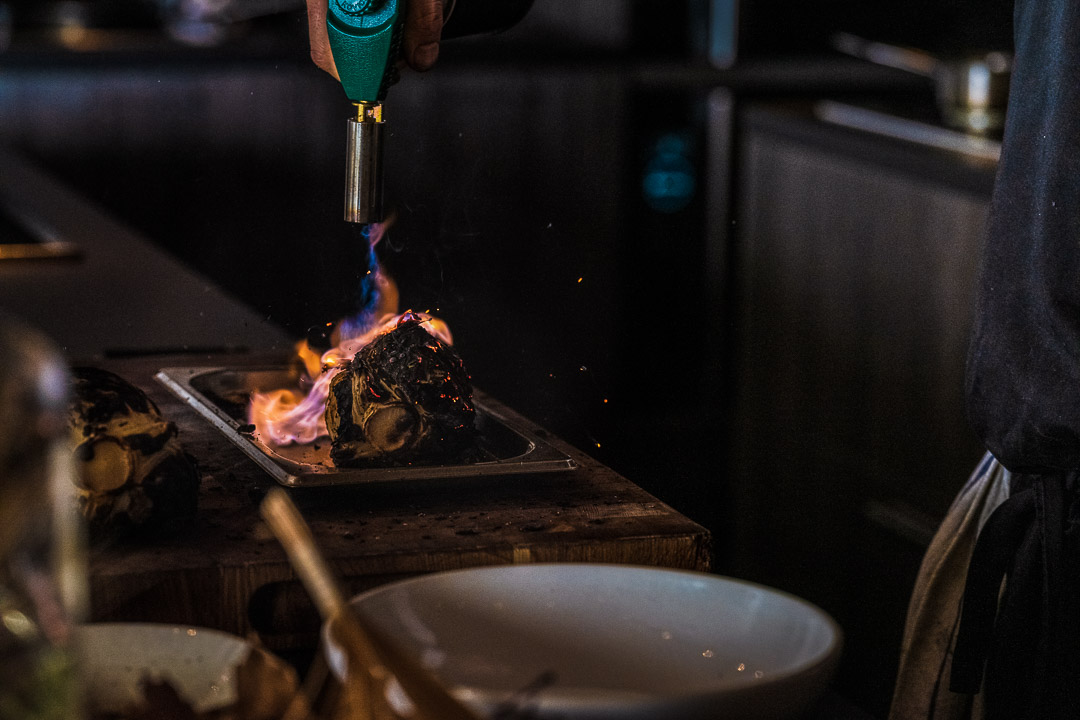 The White Rabbit by Hungry for More. Chef Vladimir Mukhin burning the quail.