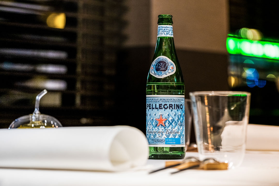 Alain Bianchin by Hungry for More. S.Pellegrino bottle at the restaurant.