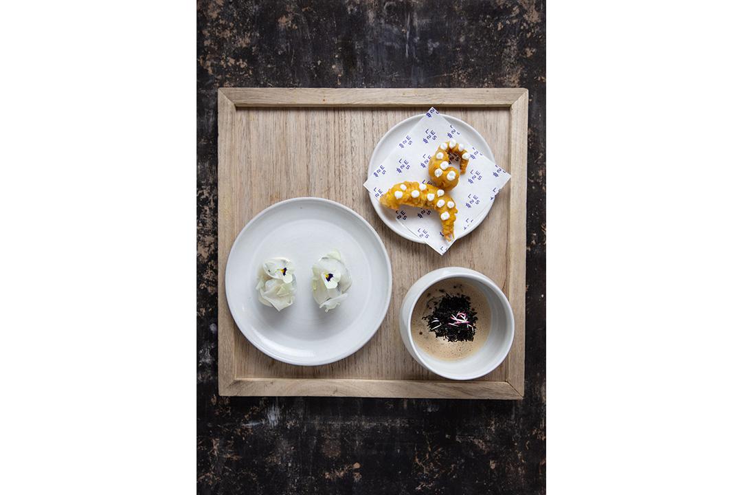 Starter of a caviar explosion cherry wood smoked ratte potatoes & tea smoked sweet potato